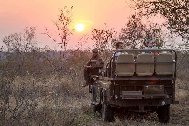 Tracker, Enoch, in position on the nThambo game vehicle. ©Em Gatland