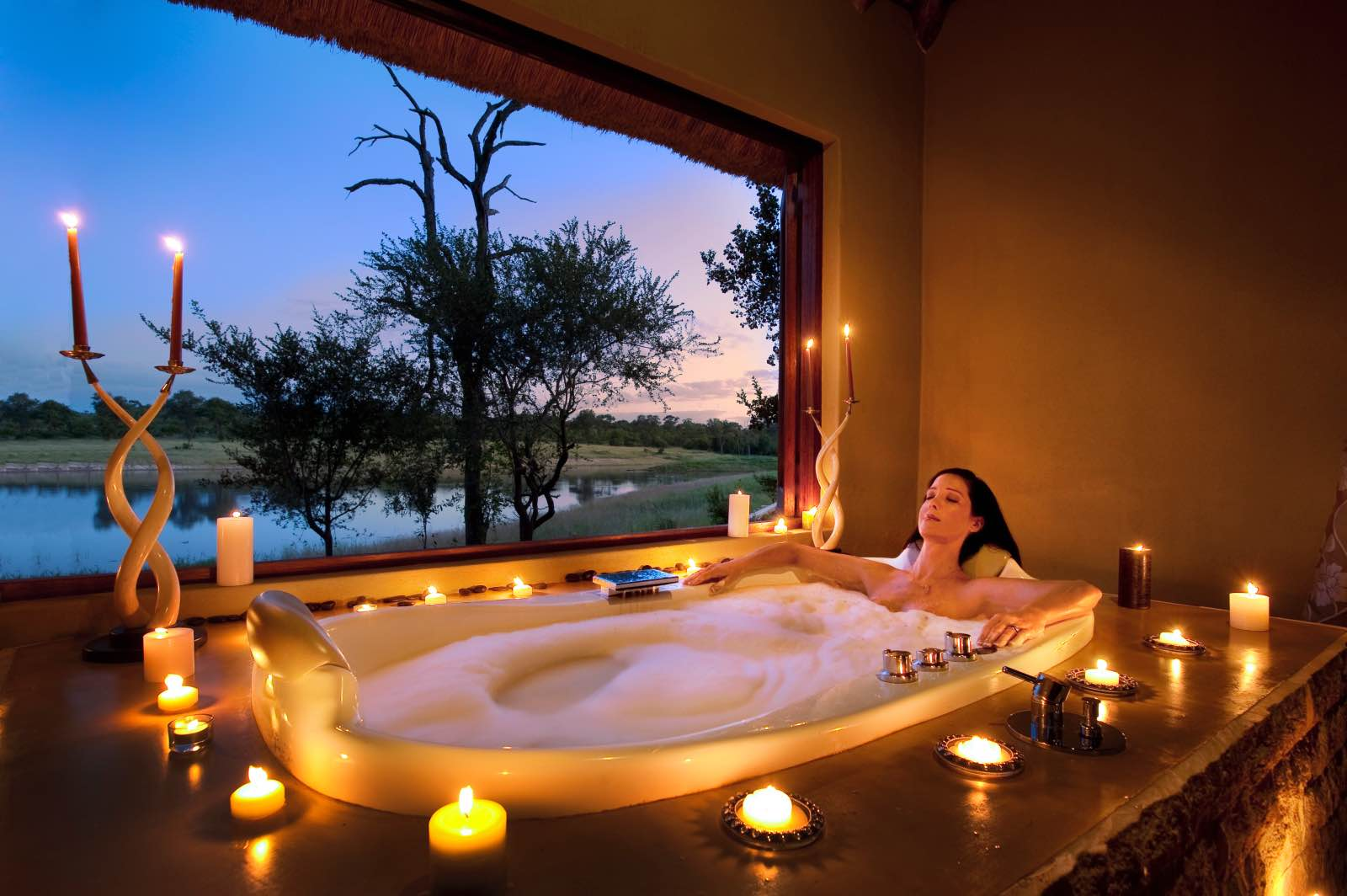 Candlelit bath with a view of the waterhole at Arathusa Safari Lodge spa