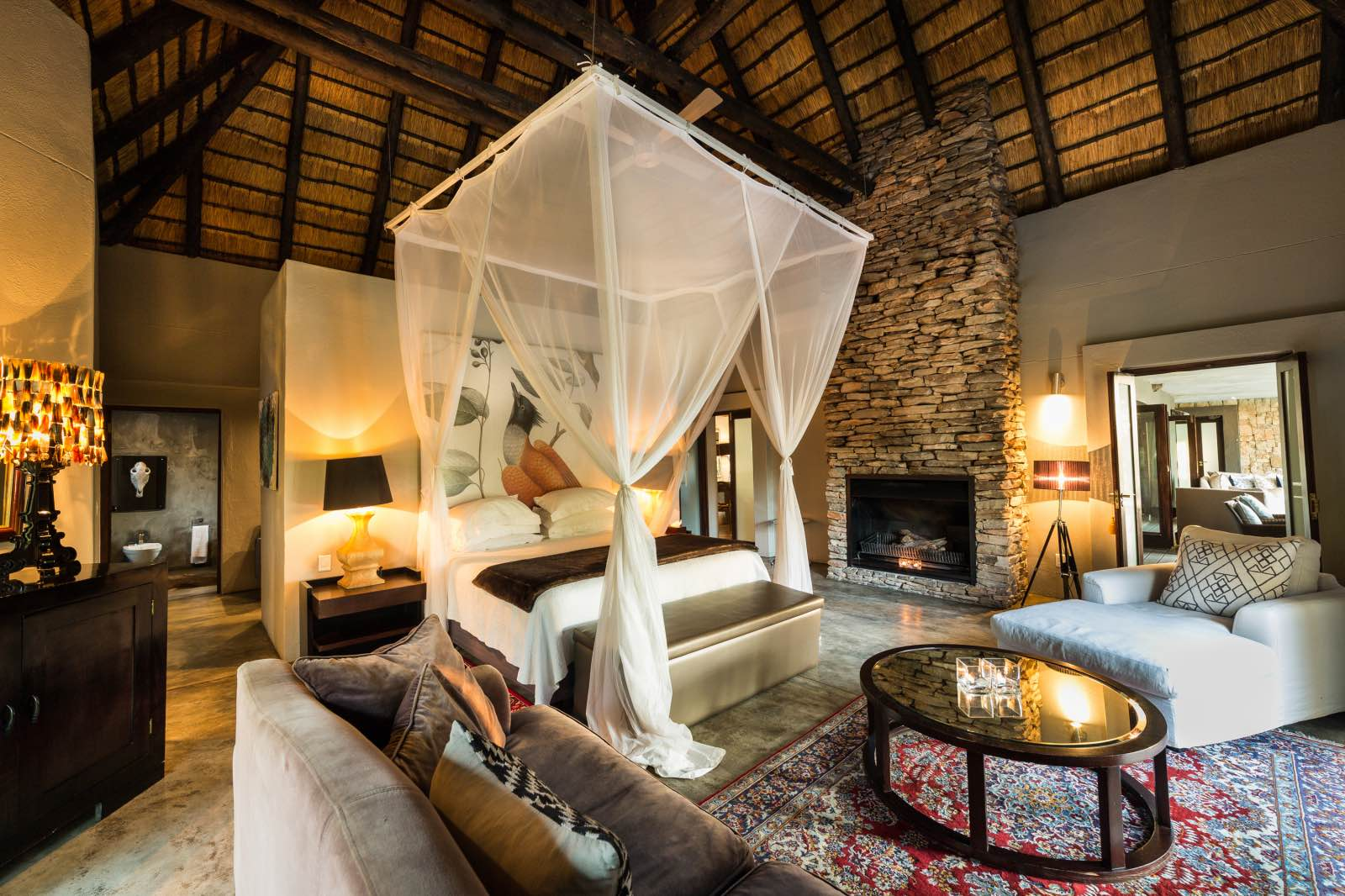 Chitwa House bedroom suite with high thatched ceiling and exquisite detail
