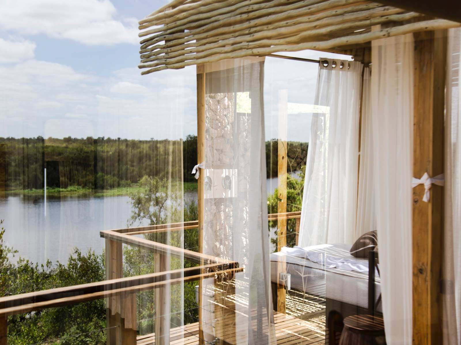 Simbavati Hilltop Lodge romantic outdoor bedroom with views of the river below