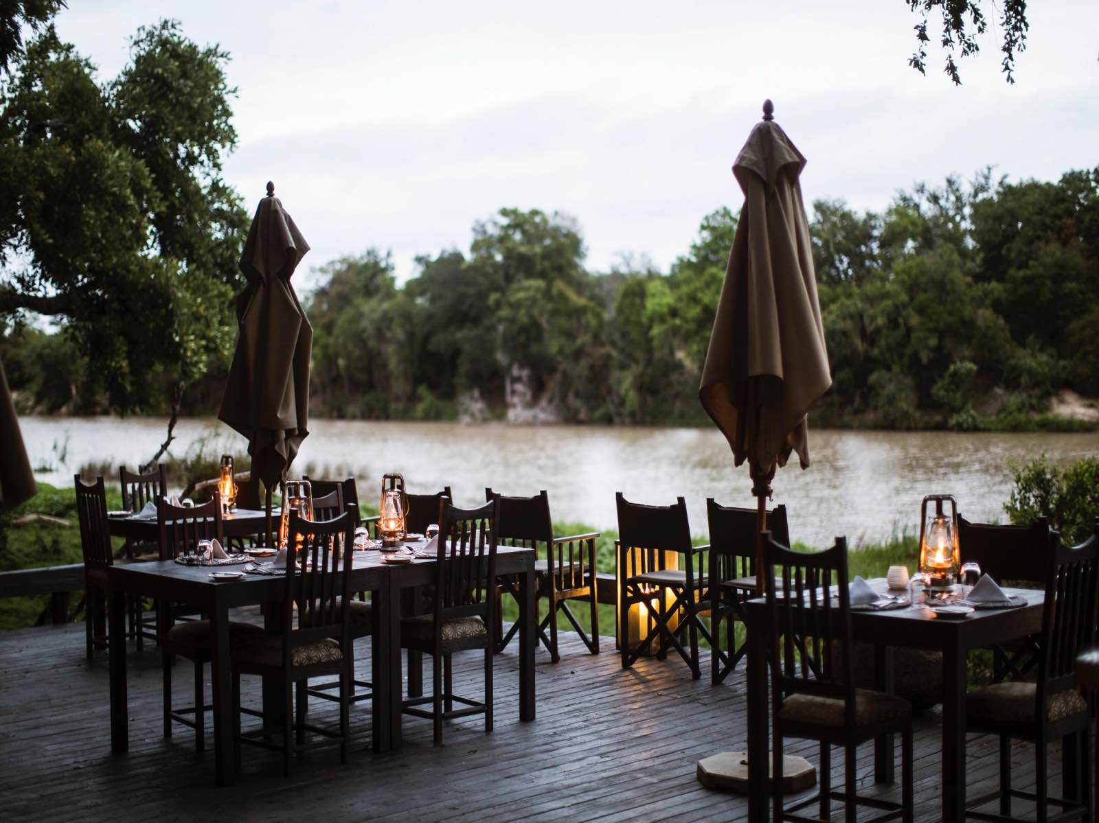 Simbavati River Lodge dining deck overlooking the Nhlaralumi River in flood during summer