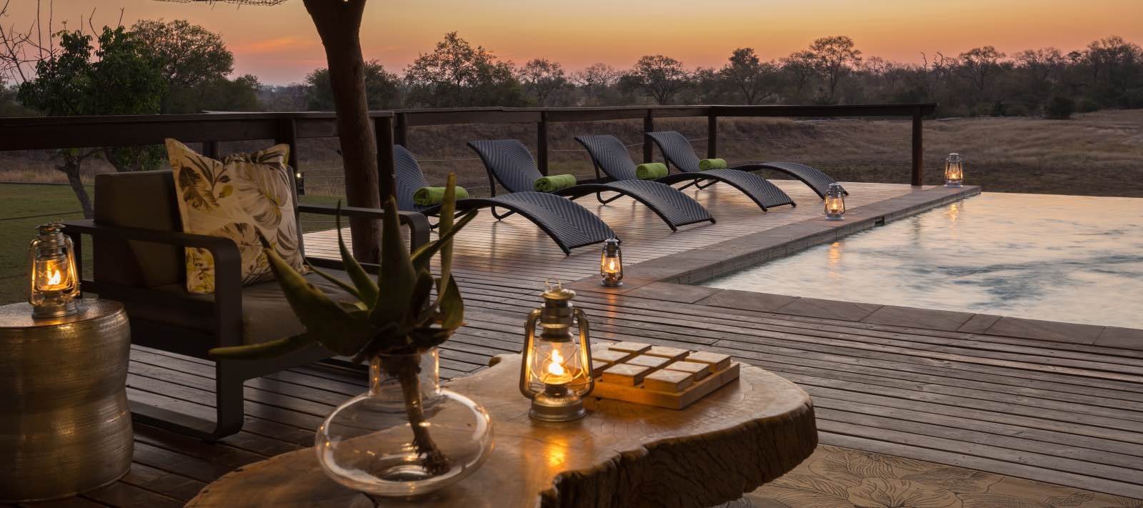 Sunset at the infinity pool, watching the activity on the open plain at Arathusa Safari Lodge