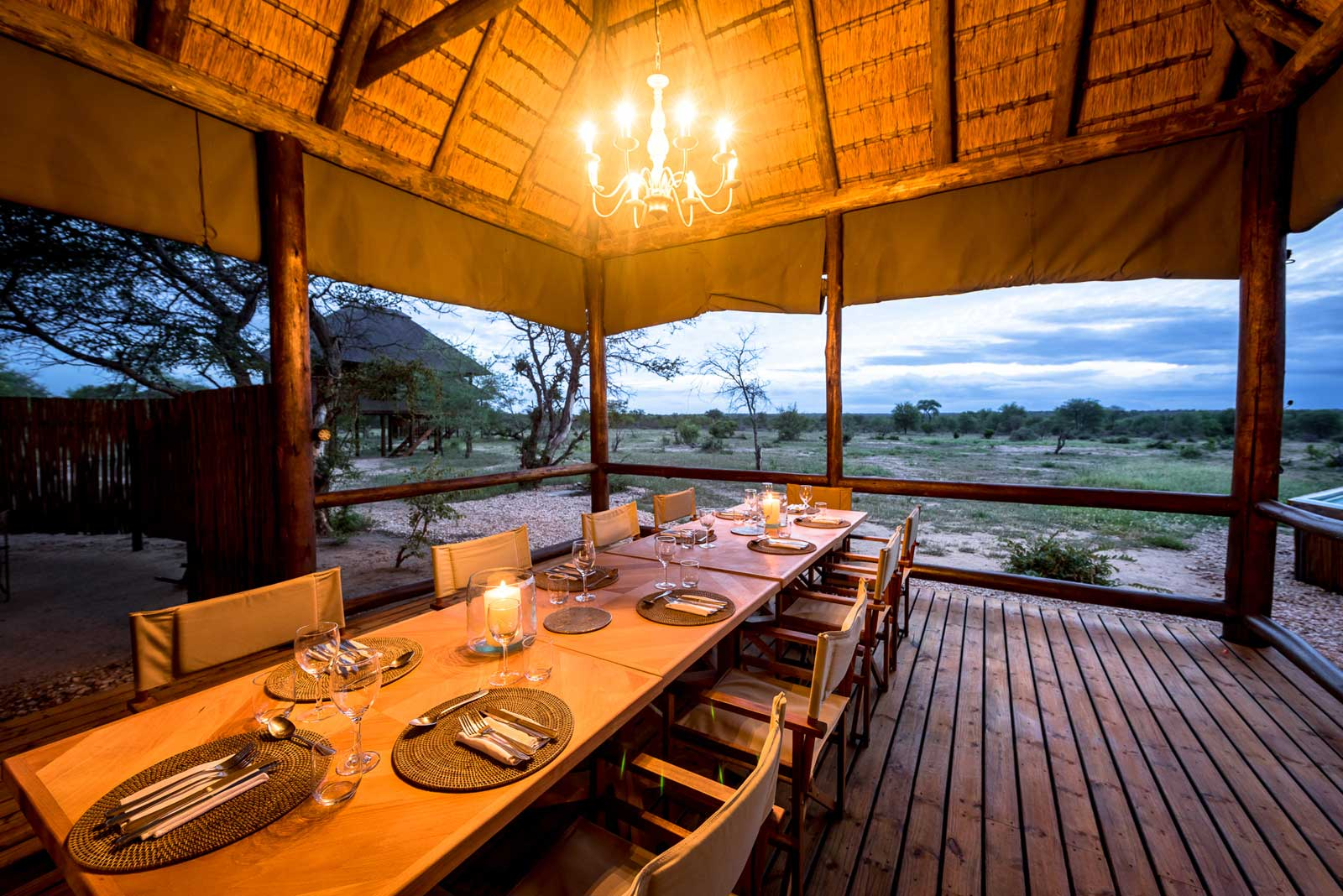 The dining area at nThambo Tree Camp, opened up to look onto the surrounding bush