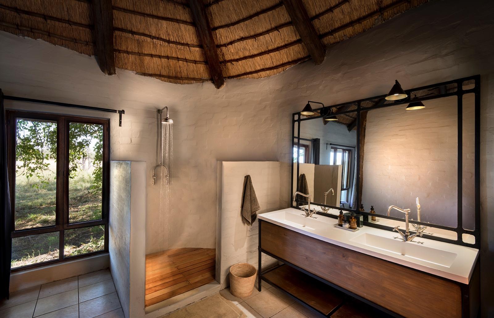 Khwai Bush Camp en suite bathroom with indoor facilities