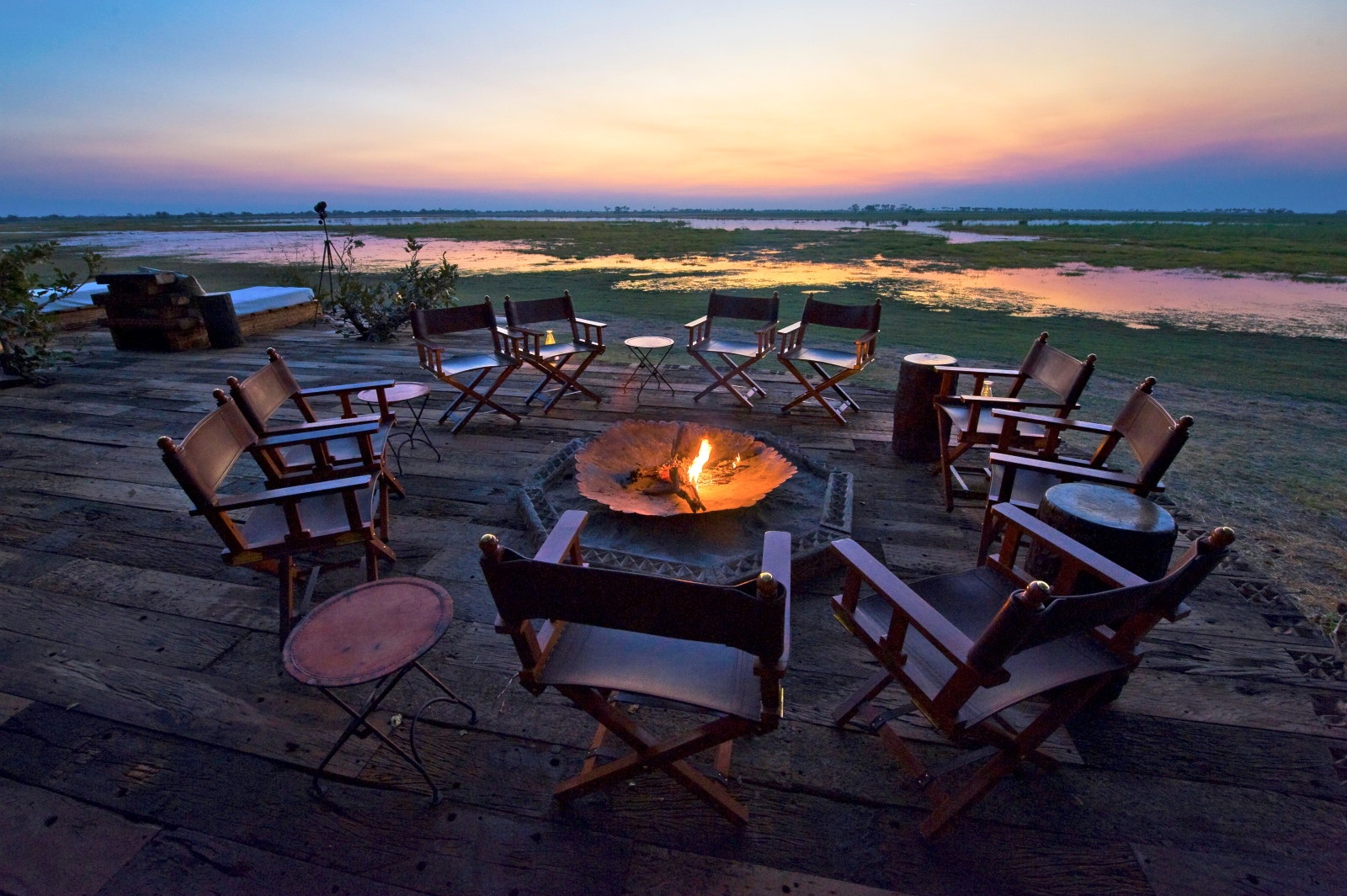 Zarafa Camp open-air boma overlooking the lagoon at sunset