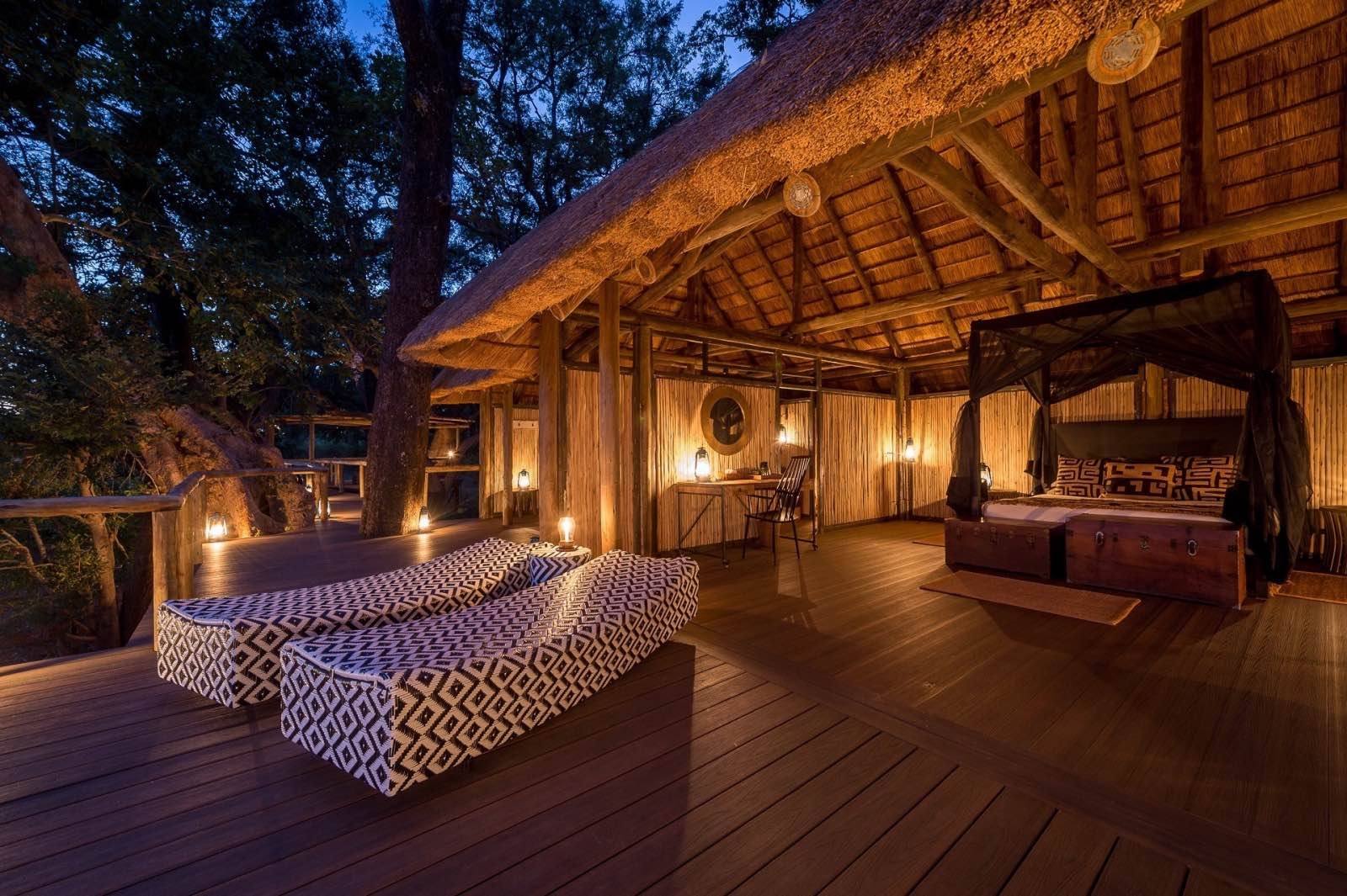 Romantically lit, open air bedroom at Chamilandu