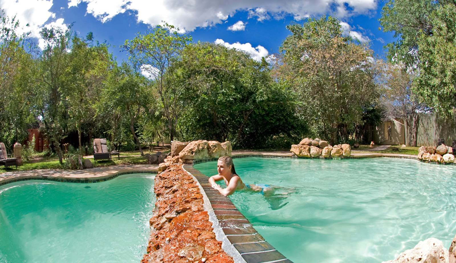 A refreshing swimming pool with a view of the Chobe River below at Chobe Chilwero