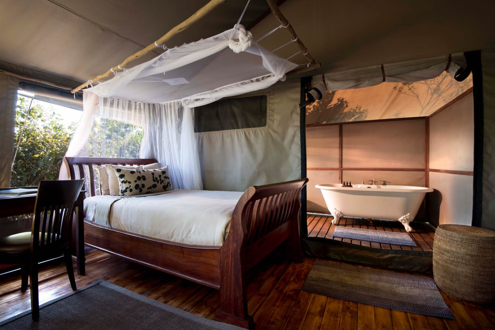 Inside the tented rooms at Linyanti Ebony with wooden floors and bath tubs