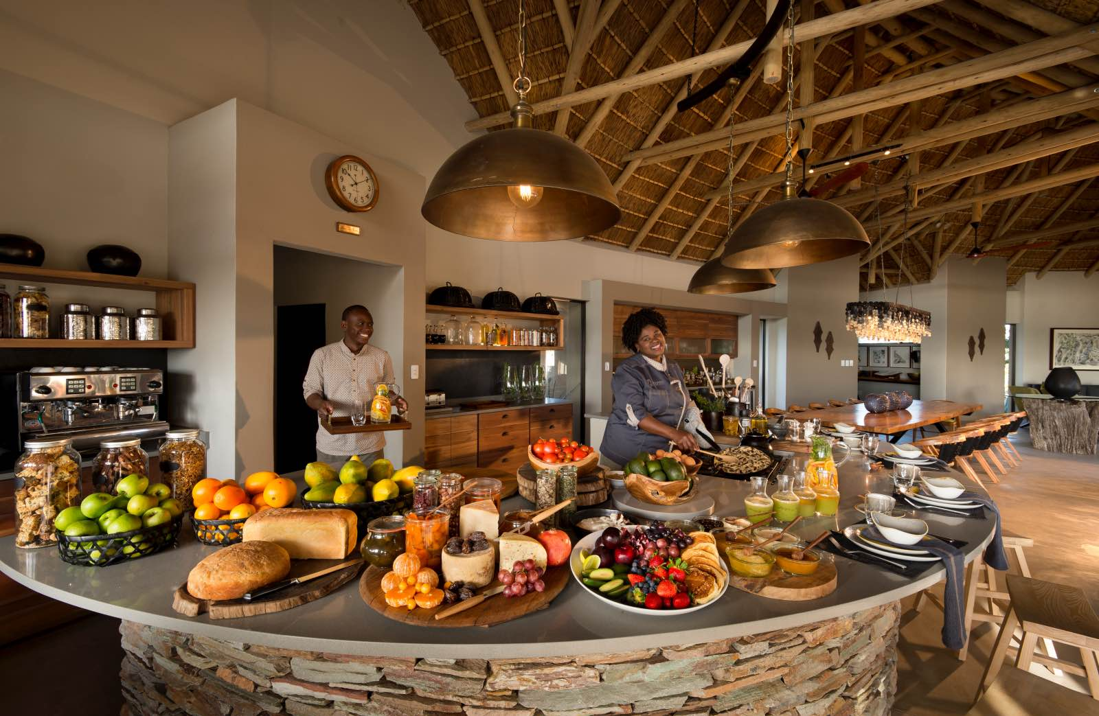 Interactive open-plan kitchen with plenty of fresh produce and chefs at work