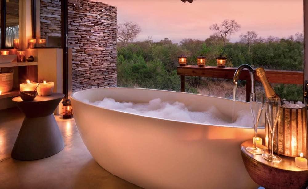 RockFig Safari Lodge ensuite bathroom with candlelit bath tub and a view