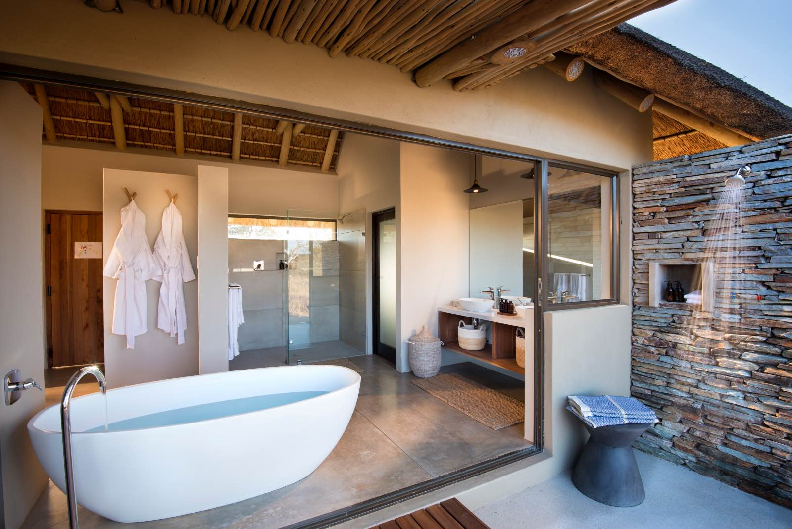 Rockfig en suite bathroom with indoor and outdoor shower and bath tub with a view
