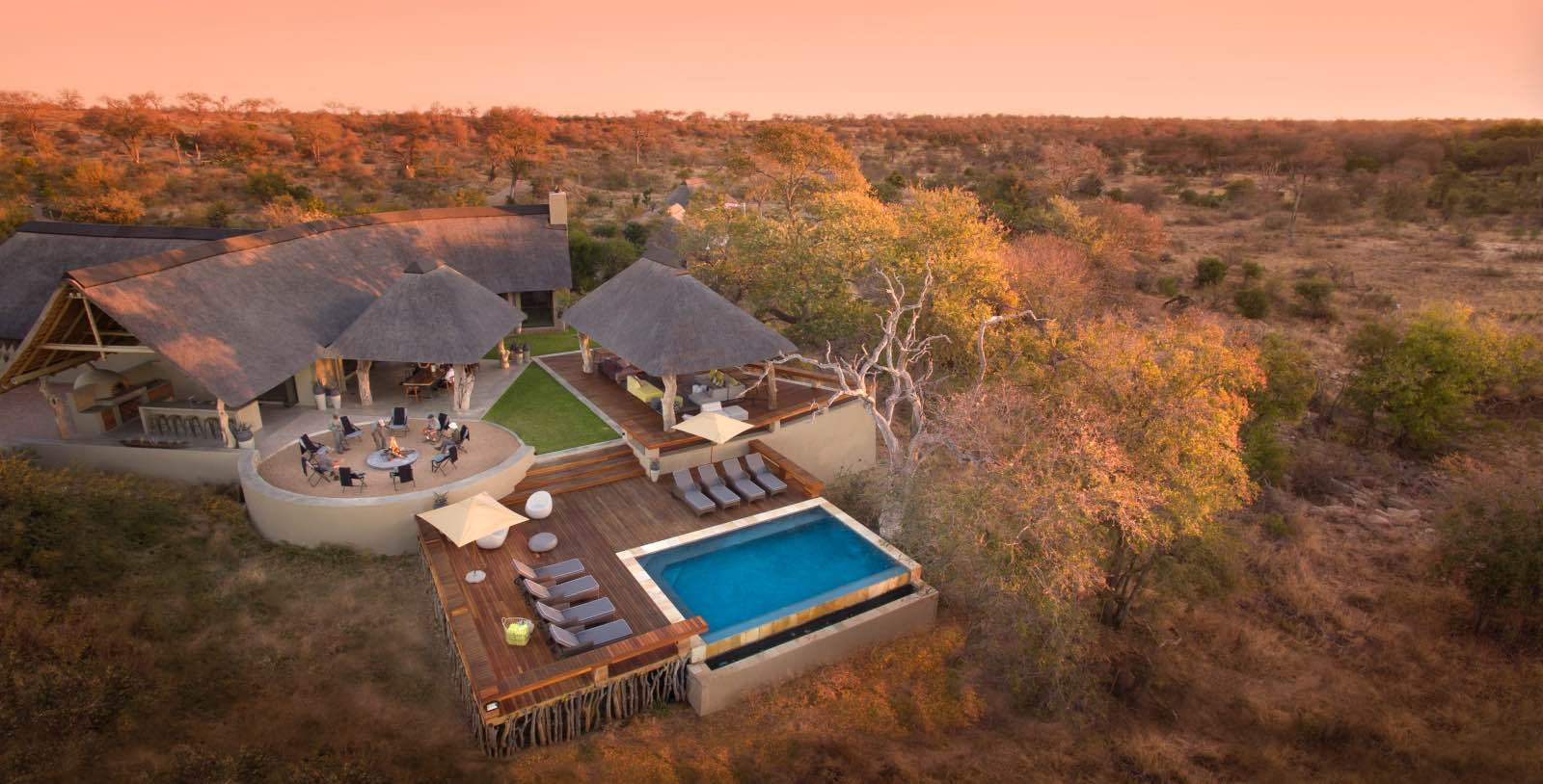 Rockfig from the air looking down on the pool, boma, and main lodge under thatch