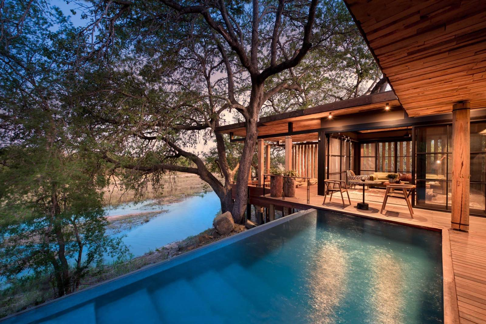 A Tengile suite with private lap pool and a view of the river