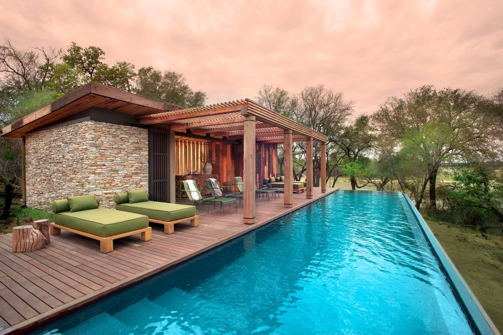 A long lap pool and plenty of space to relax and lounge alongside it
