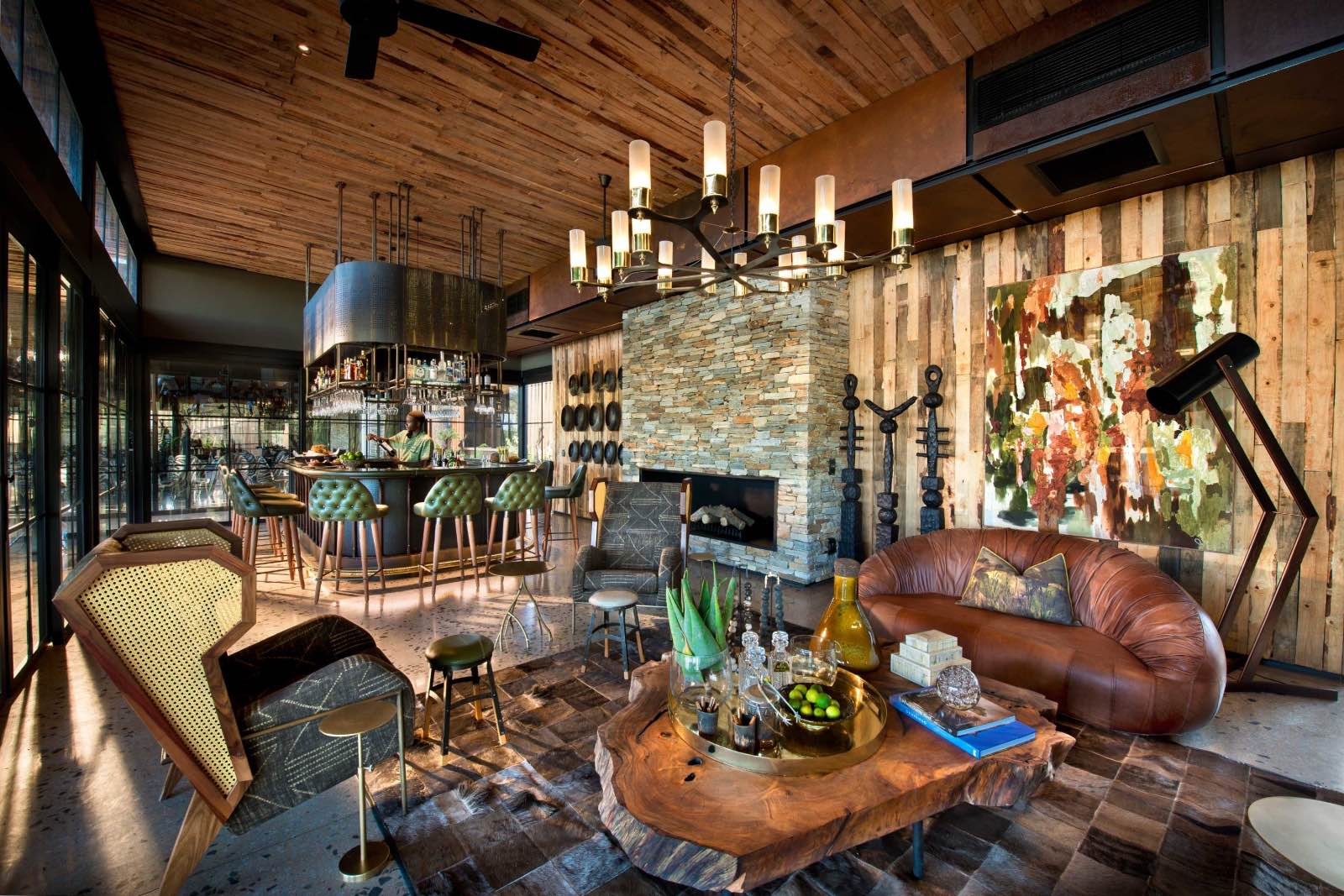 Bar and lounge with artistic, organic decor at Tengile River Lodge