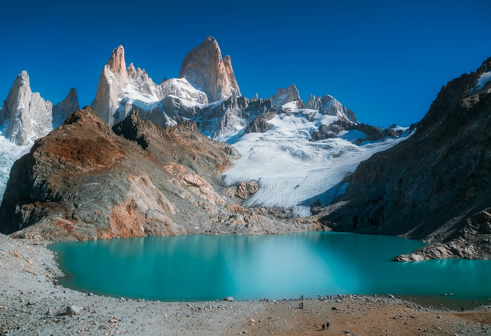 Hiking to the base of Mount Fitz Roy where a shimmering blue lake pans out beneath the granitic spears