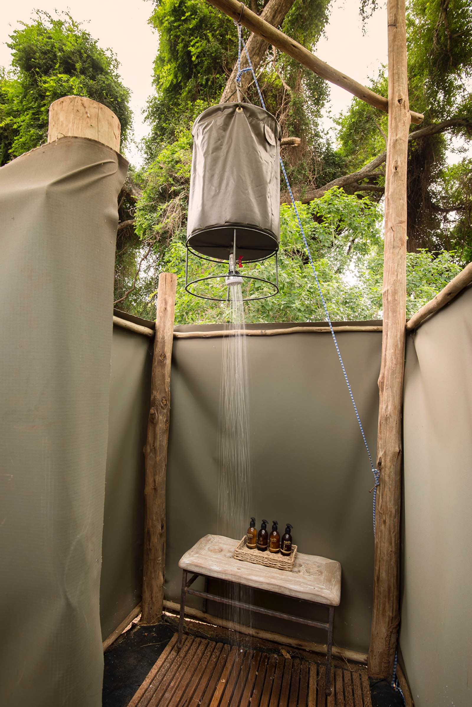 Private bucket shower attached to each tent at Pafuri Trails Camp
