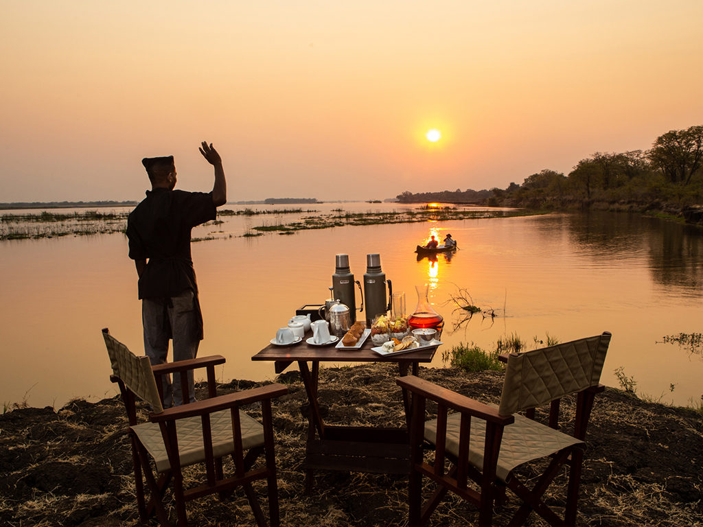 Breakfast for two shared on the banks of the Zamezi after an early morning canoe excursion