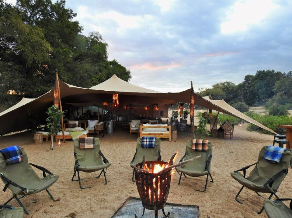 Cosy fireplaces and blankets for evenings under the stars, and a sheltered area under canvas