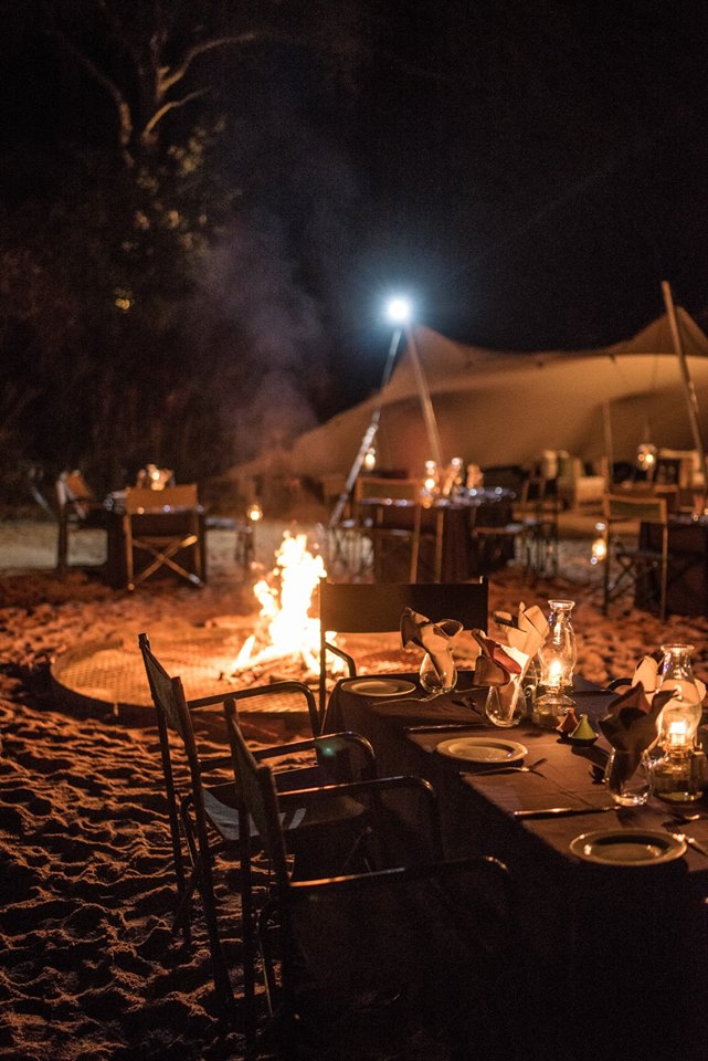 Eating outdoors under the stars alongside a roaring fire in the Kruger National Park