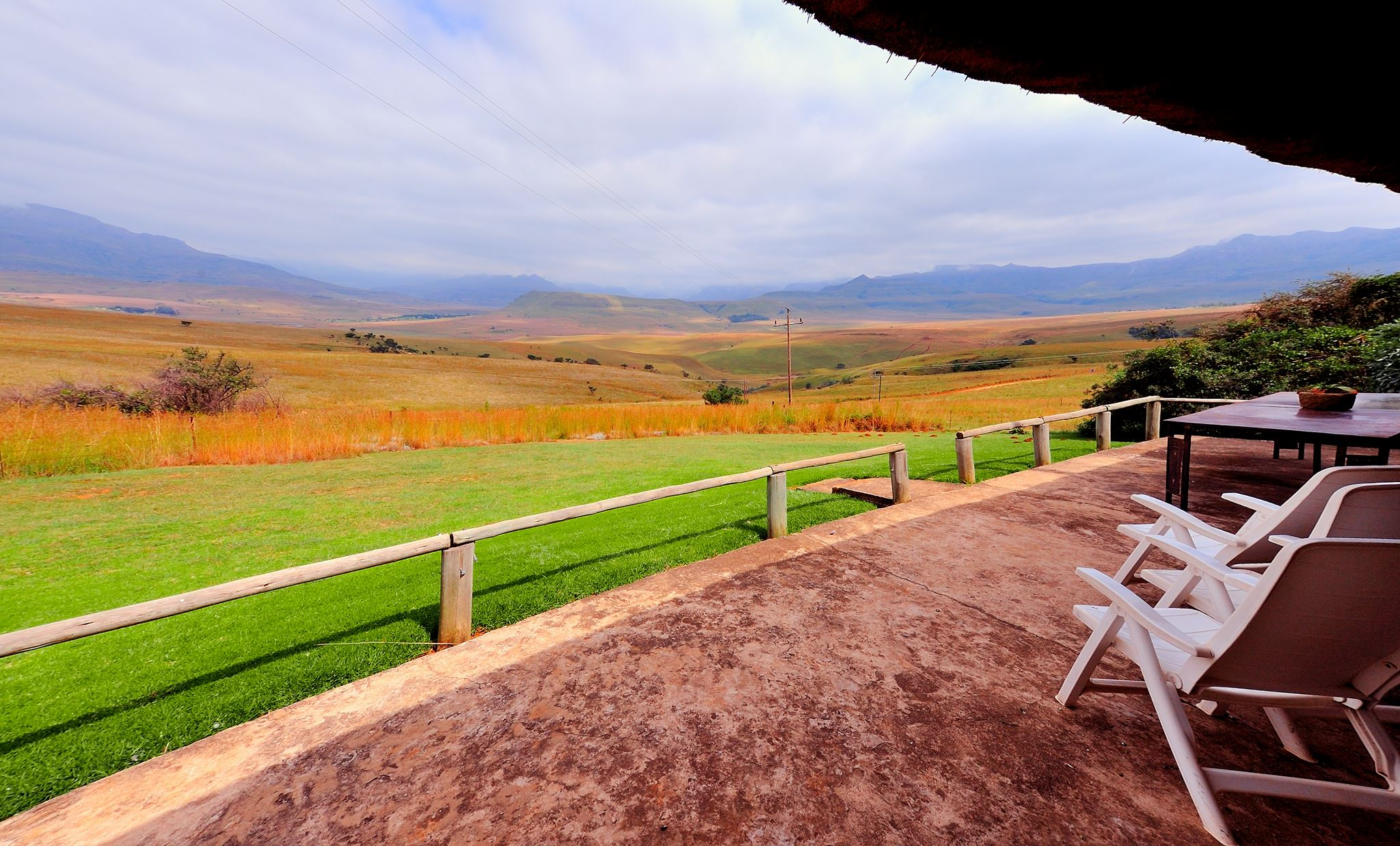 Relax on the verandah of your self-catering cottage at Berghouse in the Drakensberg