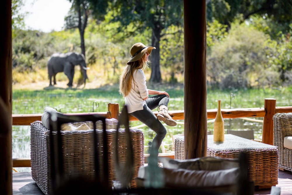 Solo traveller on safari with an elephant in the background